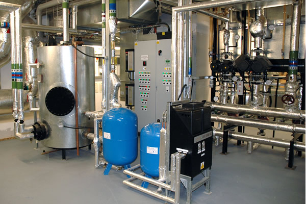 Plant room showing hws cylinder and floor standing enclosure.